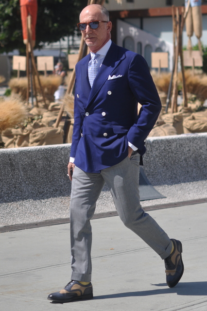 Blue jacket and grey trousers -