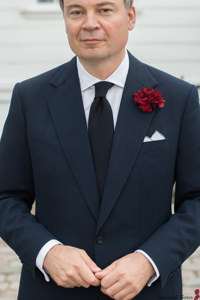 carnation in lapel buttonhole